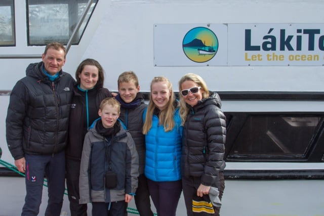 The Whole Family and Marie in Front of the Láki Tours Boat in April 2016