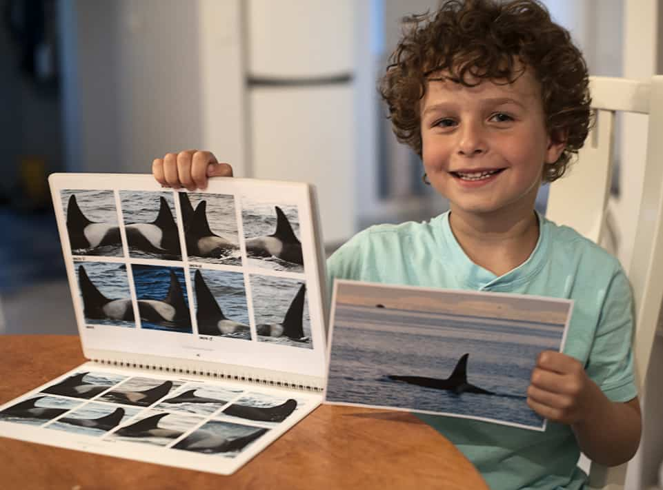 Thor with the Orca ID Catalogue and a Postcard of the Orca Male